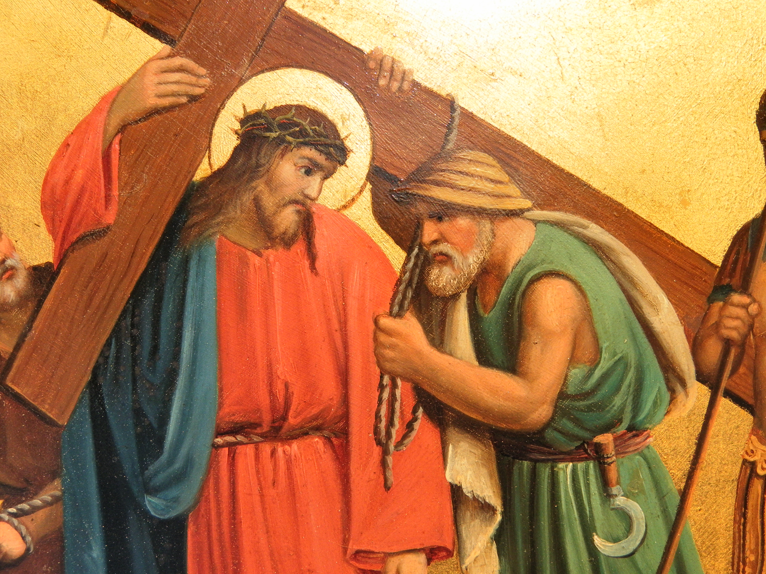 the fifth station simon of cyrene helps jesus to carry the cross